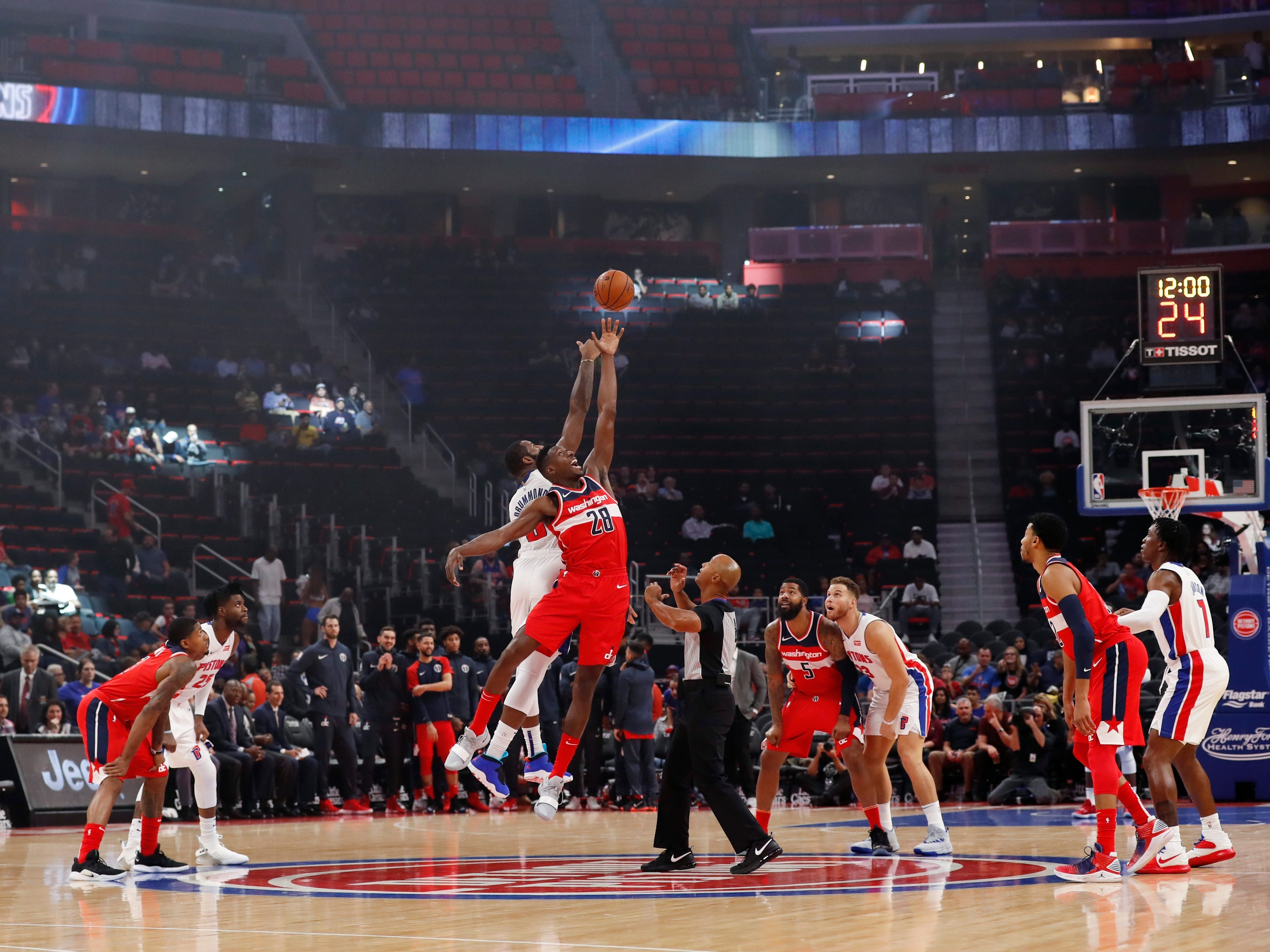 Detroit Pistons center Andre Drummond and Washington Wizards center Ian Mahinmi (28) take the opening tip off during the first half.