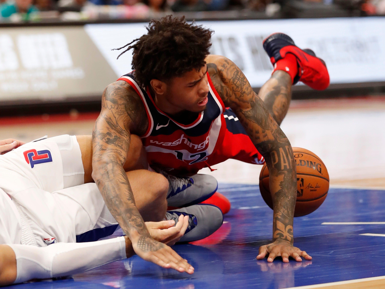 Washington Wizards forward Otto Porter Jr. runs into Detroit Pistons forward Blake Griffin (23) during the second half.