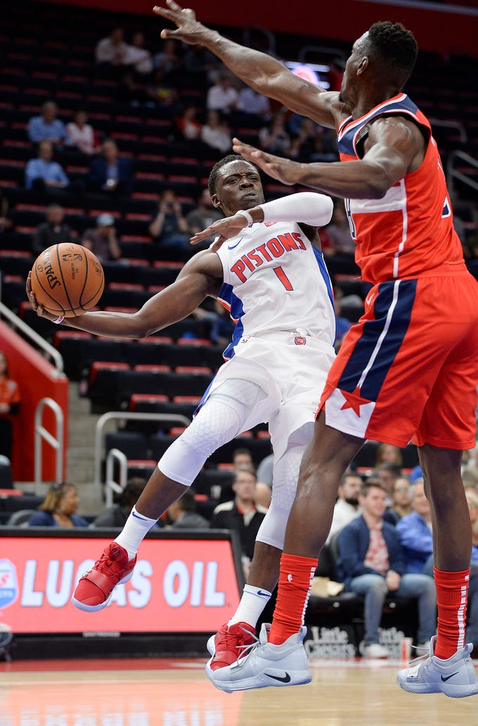 Pistons' Reggie Jackson looks to pass over the Wizards' Ian Mahinmi in the first quarter of an NBA preseason game between the Detroit Pistons and the Washington Wizards, Wednesday, Oct. 10, 2018. The Wizards won the game, 102-97.