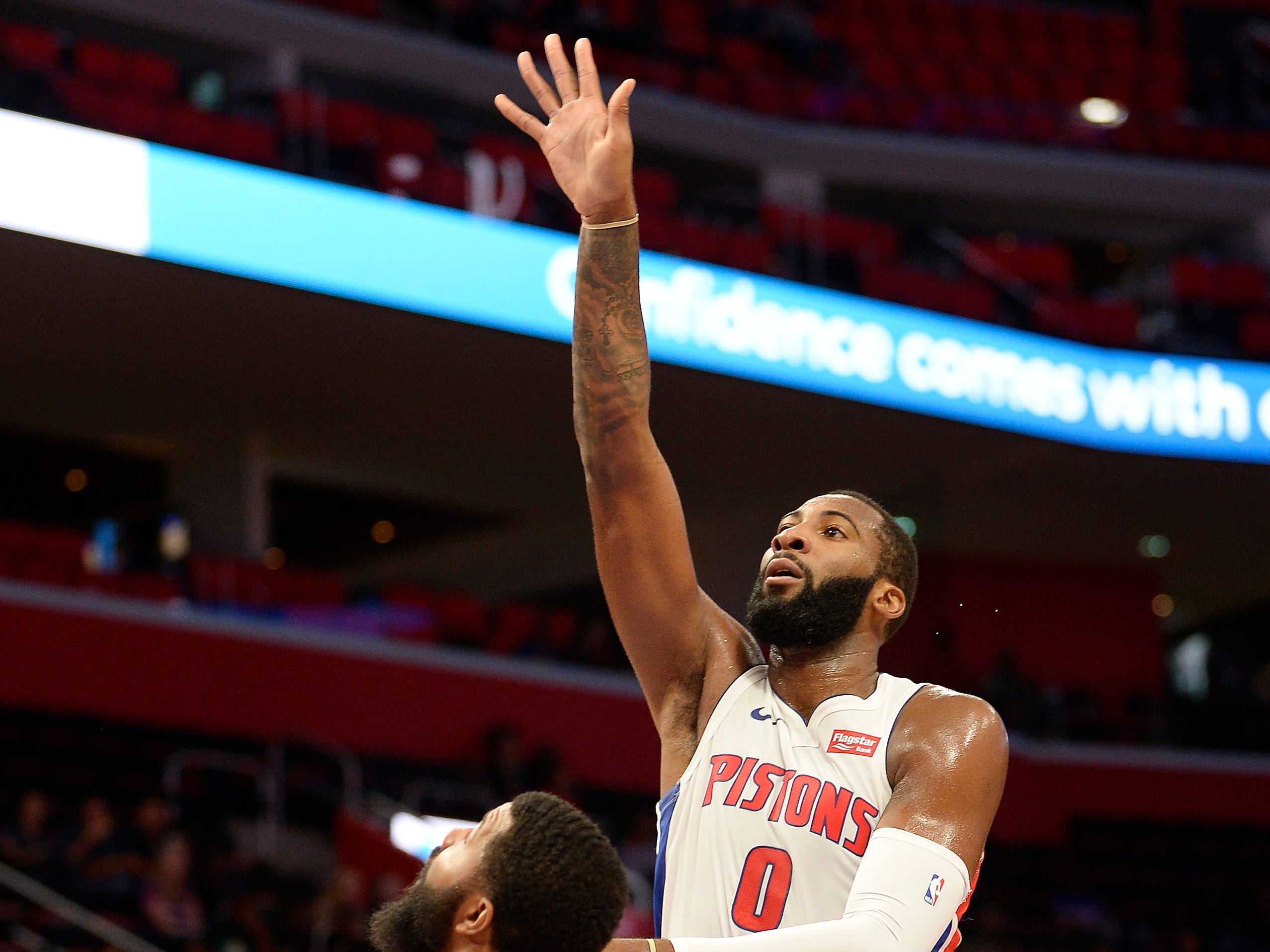 Pistons' Andre Drummond scores over Wizards' Markieff Morris in the first quarter.