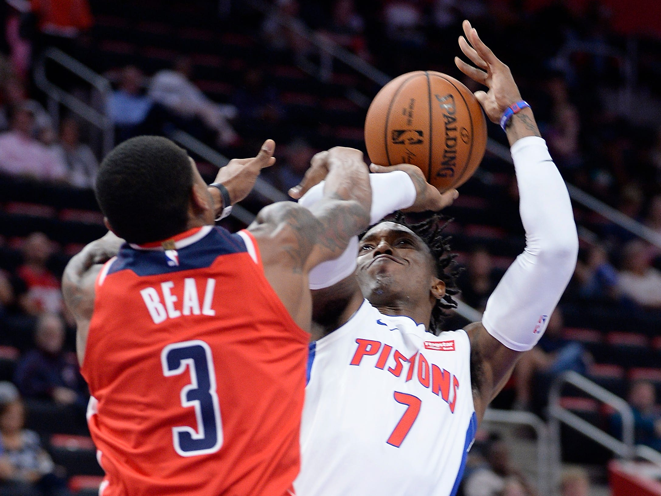 Pistons' Stanley Johnson is fouled by Wizards' Bradley Beal in the second quarter.