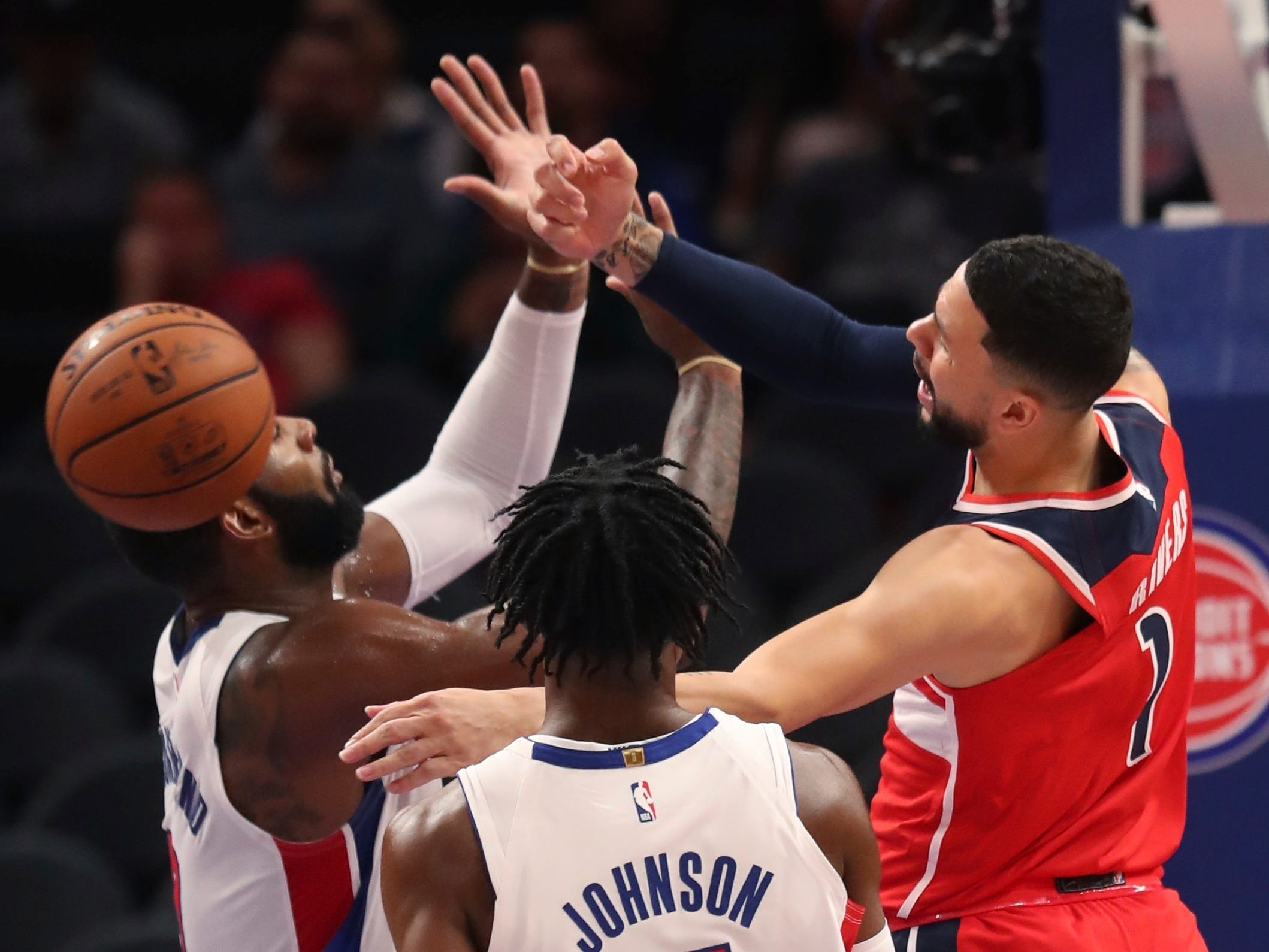 Washington Wizards guard Austin Rivers (1), defended by Detroit Pistons center Andre Drummond, left, passes the ball during the first half.