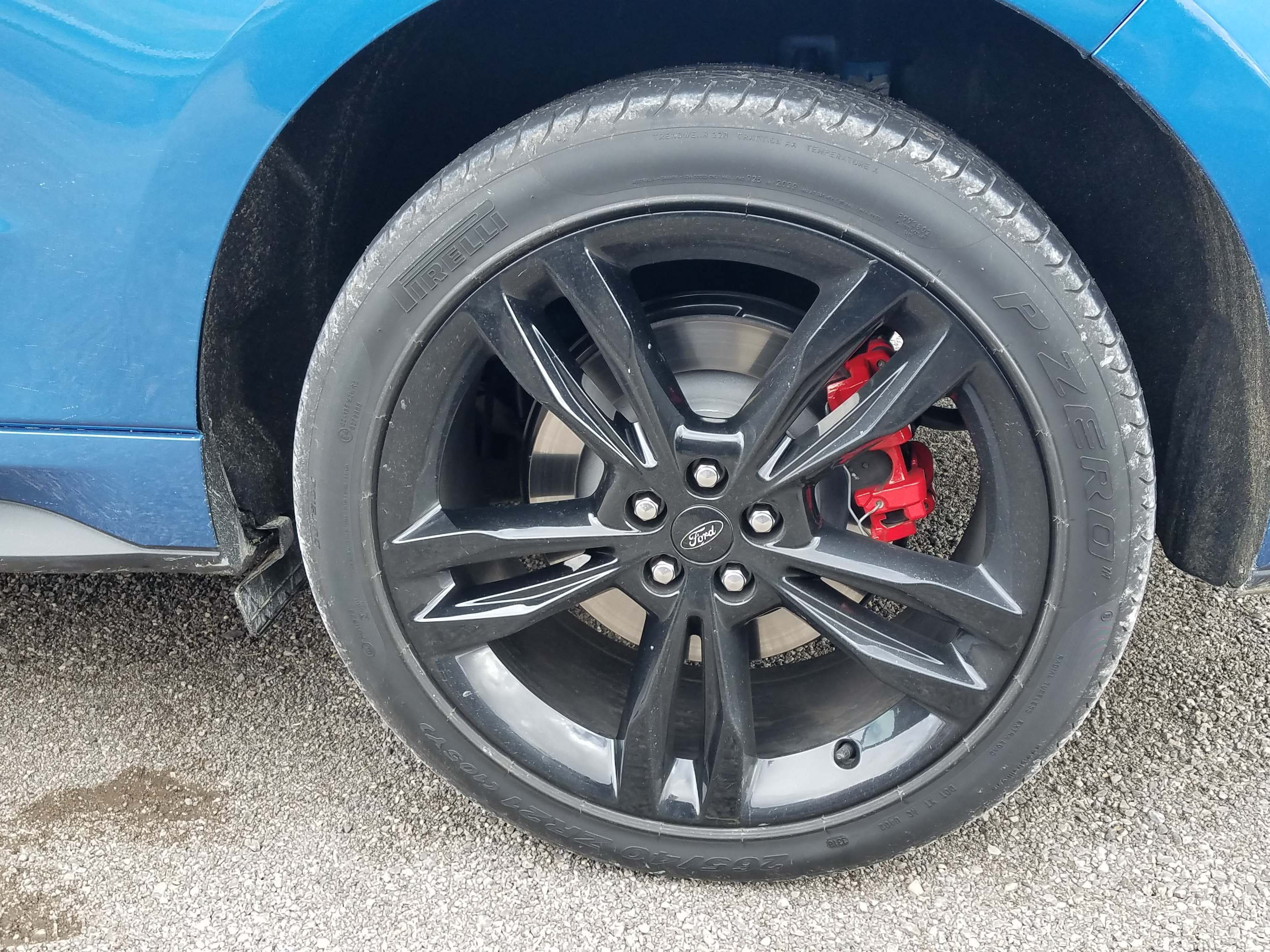 To stop the fast 2019 Ford Edge ST,  Ford Performance added vented rotors with red-hat calipers.
