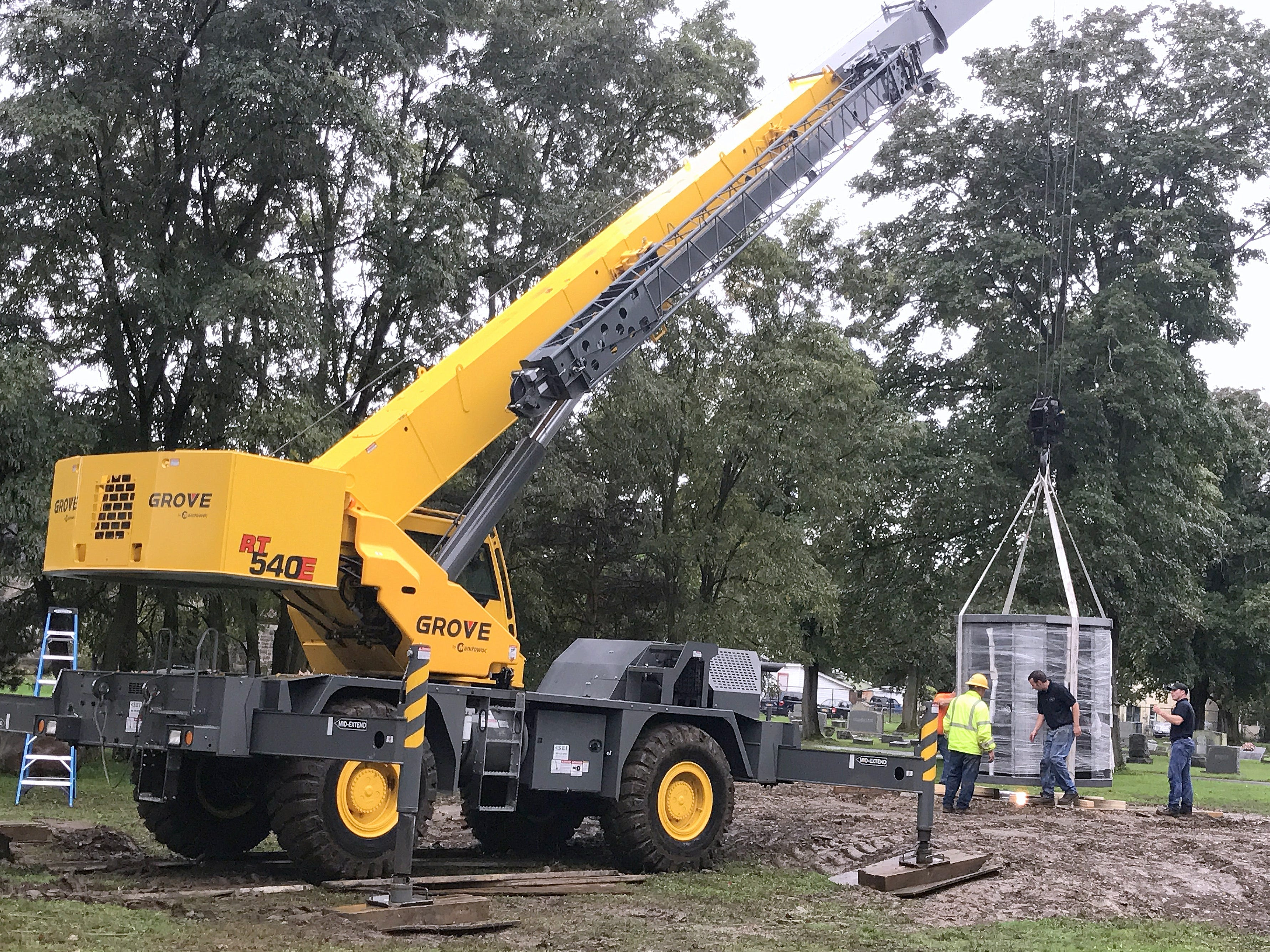 A crane lowers a 9-ton columbarium onto a platform Thursday at Woodlawn Cemetery in Elmira.