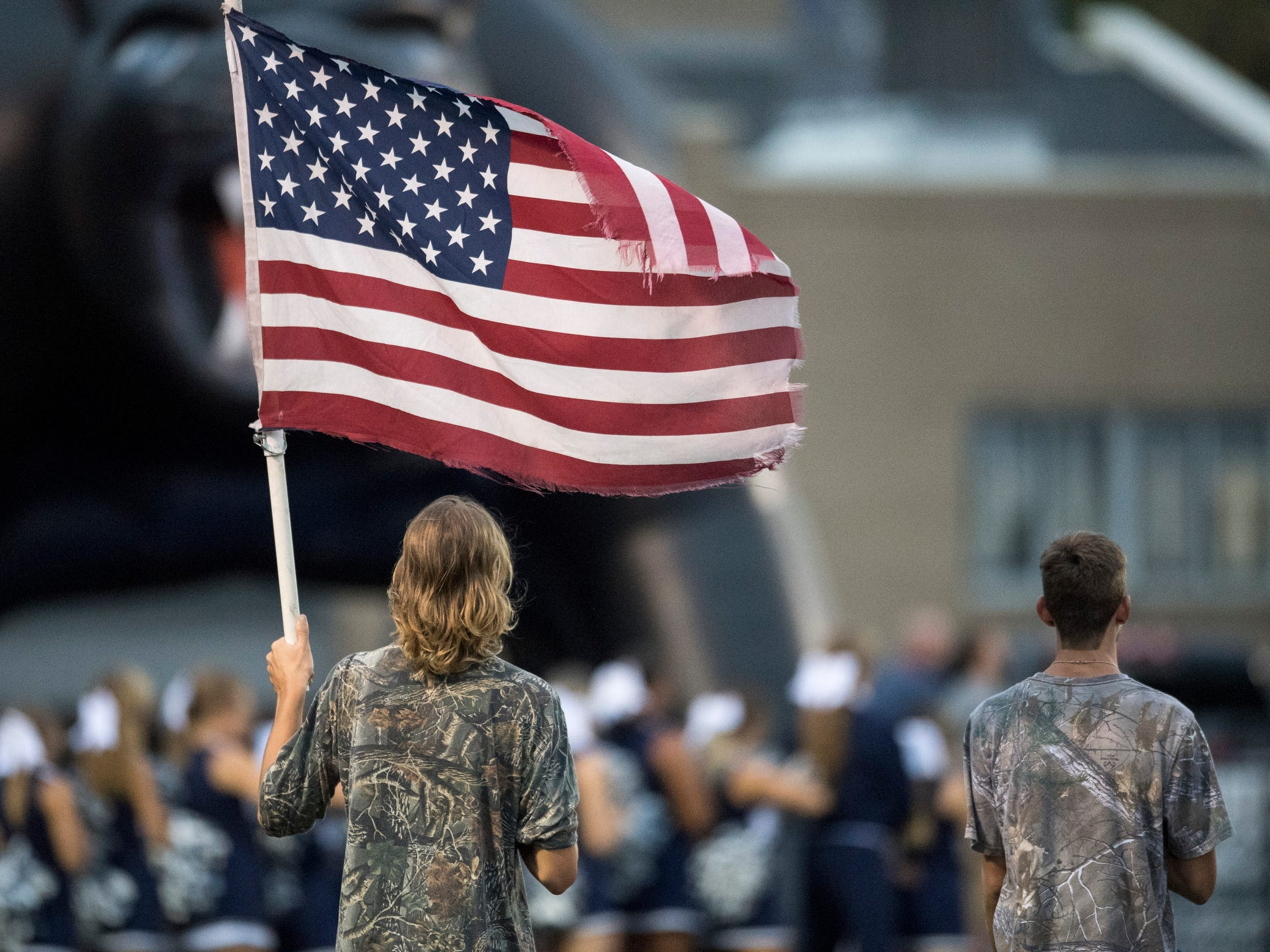 Reitz senior Max Ashby waves the flag before the Reitz Panthers take the field, Friday, September 7, 2018.