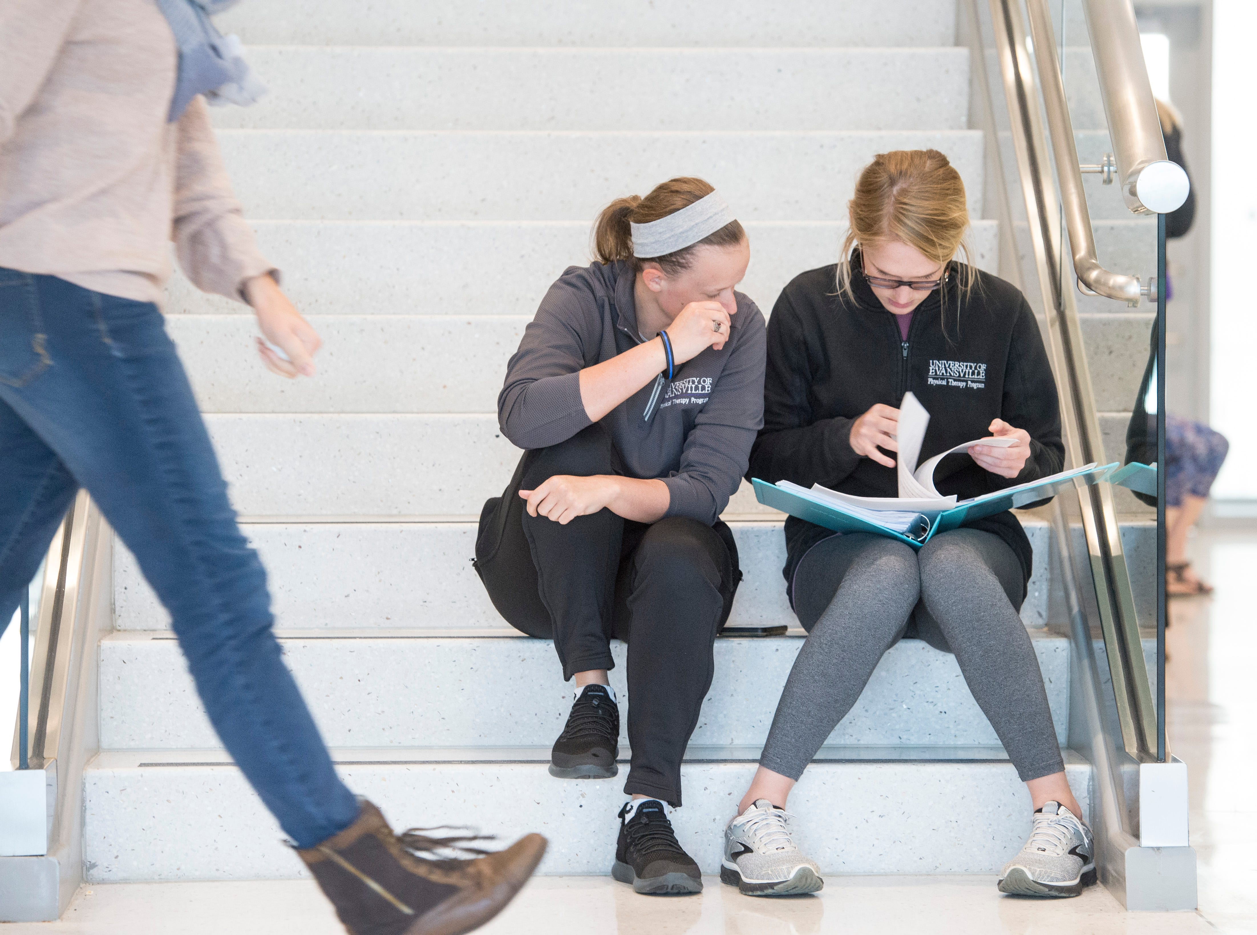 """Jessica Taul, left, and Kelsey Owen review notes on the steps inside the Stone Family Center for Health Sciences after a pharmacology test Thursday afternoon. Owen said """"just seeing what I got wrong and what I got right."""""""