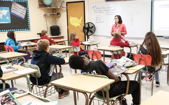 Gina Rieder teaches seventh-grade history Thursday, Oct. 11, 2018, at Sabish Middle School in Fond du Lac, Wisconsin.