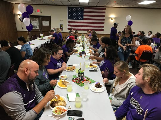 "Fremont Ross High School football players and family members enjoy a meal together Wednesday night at the ""Feed the Team"" event at the Fremont Eagles' West State Street location. The Fremont Eagles are sponsoring the weekly meals this year and provided all the food for players and their families."