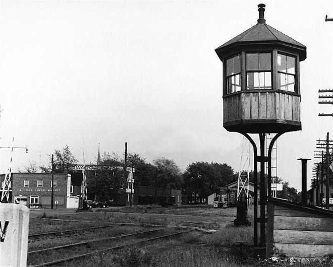 The railroad crossing tower stood on Napoleon Street in the mid-1900s.
