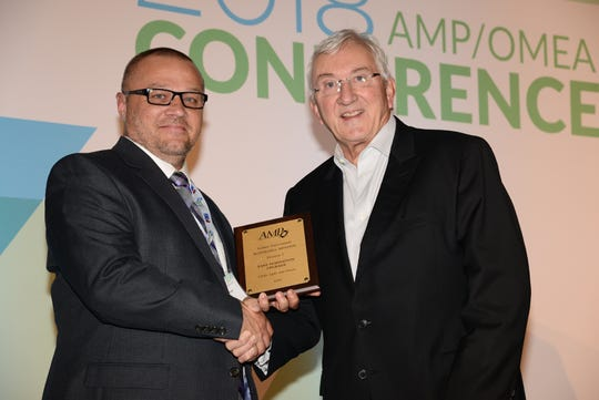 Cory Lachner, Clyde Light and Power Superintendent, receives recognition for Honorable Mention in the System Improvement category from AMP President/CEO Marc Gerken.