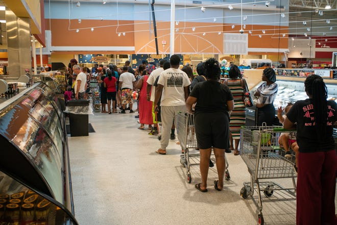 Tallahassee residents line up at Ocala Publix as it re-opens on Thursday, Oct. 11.