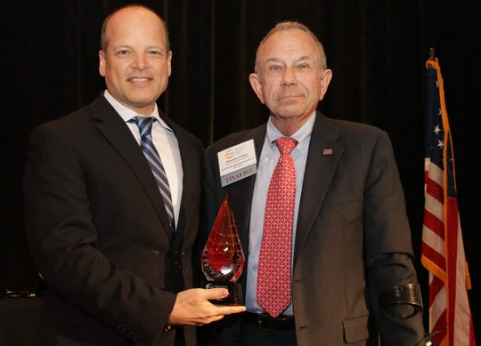 Keith Veres, Cape Coral Community Foundation board member, is pictured with recent ENPY winner Tom Uhler.