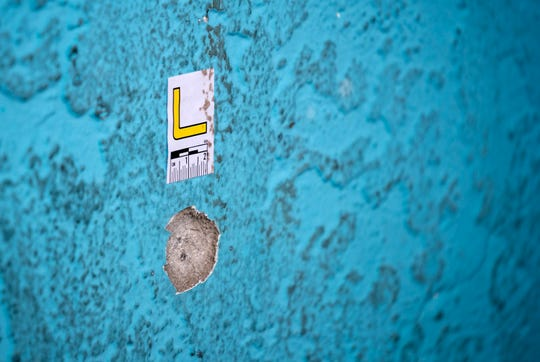 A bullet hole can be seen on the wall of Urban Swagger, a store in the Sungold Plaza at Hanson Street and U.S. 41 in Fort Myers. The plaza was the scene of a shooting Wednesday night at Hanson Street and U.S. 41 in Fort Myers that left two men dead.