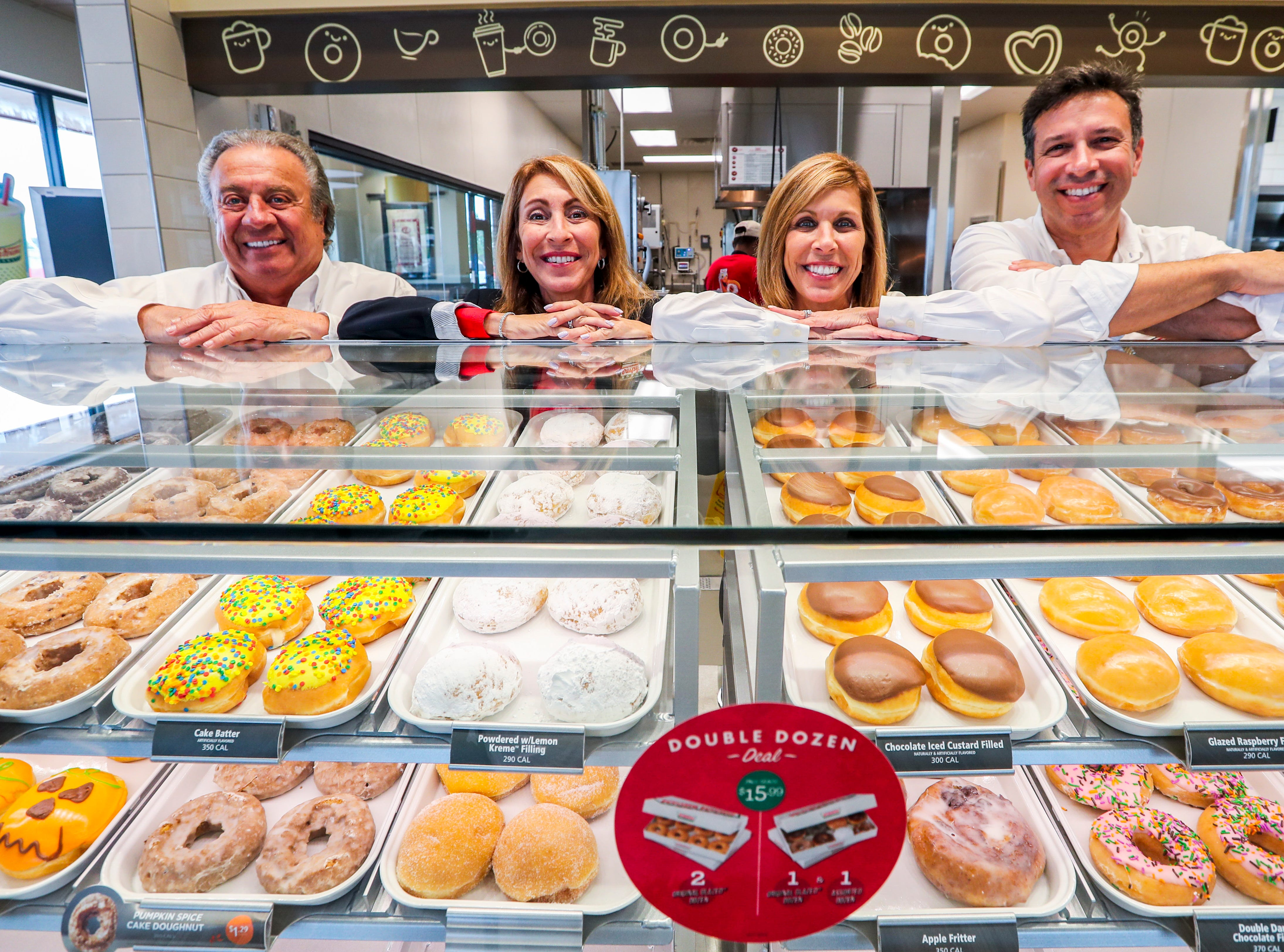 L to R, Jim Cosentino, his daughters, Marialana Lococo and Jeanine Cieri, and his nephew, Chris D'Angelo, are days away from opening Krispy Kreme in Fort Myers.