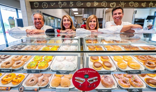 From left,  Krispy Kreme franchise owners Jim Cosentino, his daughters, Marialana Lococo and Jeanine Cieri, and his nephew Chris D'Angelo are days away from opening their first store in Fort Myers.