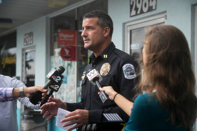 Capt. Jay Rodriguez, of the Fort Myers Police Department, speaks Thursday about a shooting that left two dead Wednesday night at Hanson Street and U.S. 41 in Fort Myers.