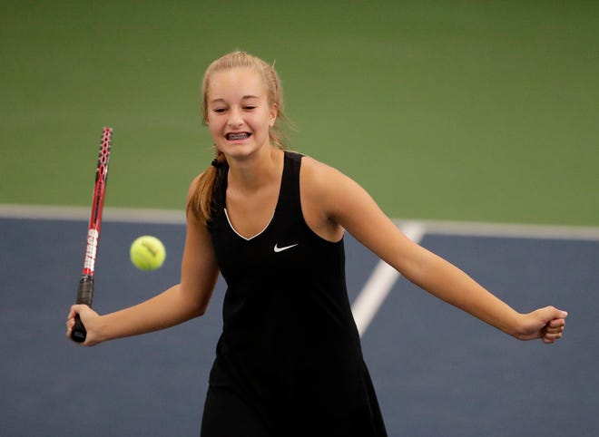De Pere's Tristyn Lueck reacts after missing a volley in a first round Division 1 doubles match at WIAA 2018 Girls State Tennis Tournament at Nielsen Tennis Stadium on Thursday, October 11, 2018 in Madison, Wis.