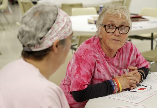 First Presbyterian Church food pantry volunteer and board member Stephanie Fahringer, right, talks with former client Genia Swafford in the church's fellowship hall on Thursday in Green Bay.