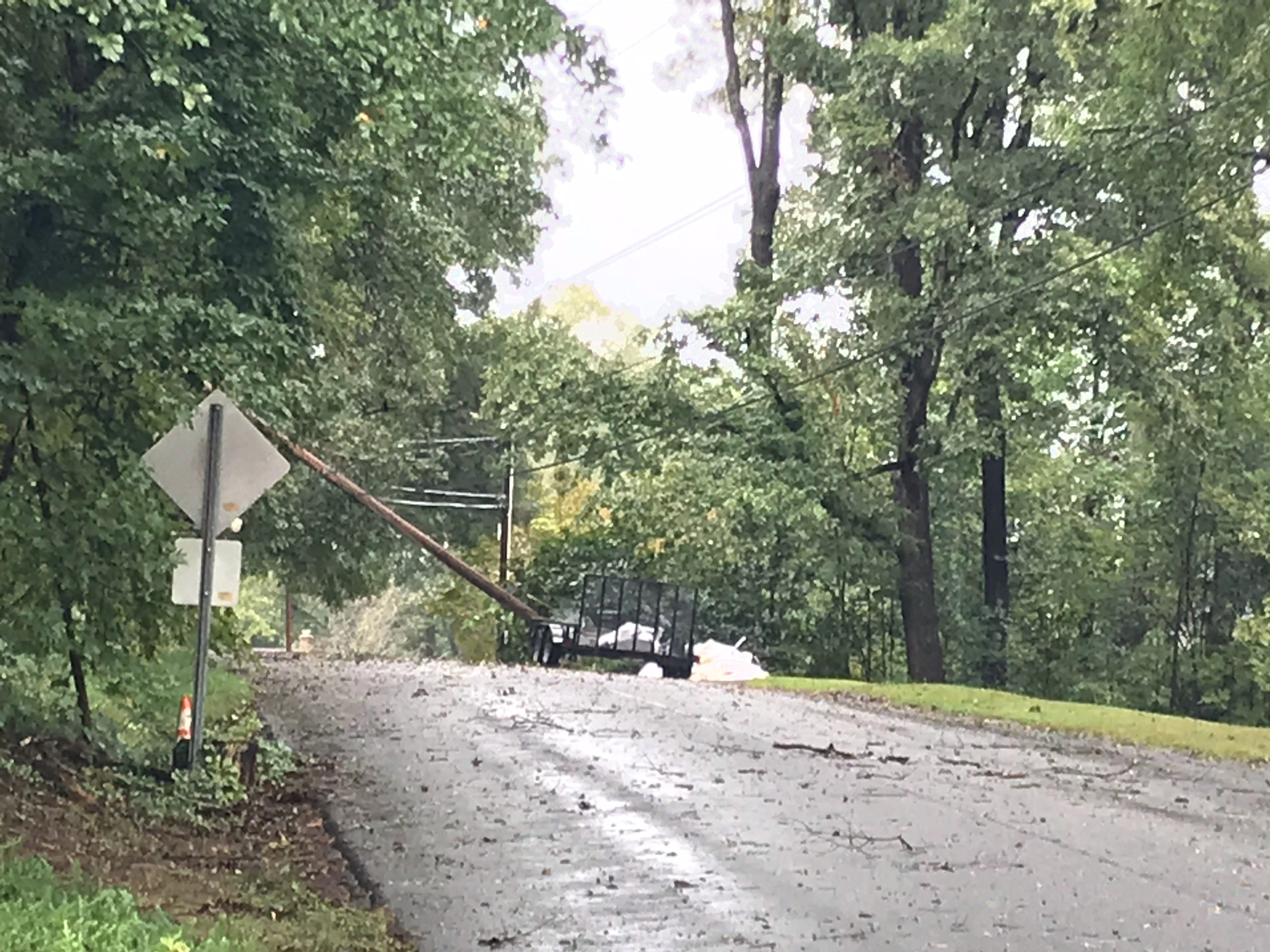 A tree took out a utility pole on Lotus Court in Greenville on Thursday, Oct. 11, 2018, as Tropical Storm Michael moved into the area. Utility crews preparing to cut power to the neighborhood so that the pole can be replaced.