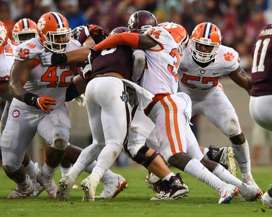 Clemson linebacker Kendall Joseph (34) brings down Texas A&M running back Trayveon Williams (5) during the 1st quarter at Texas A&M's Kyle Field in College Station, TX Saturday, September 8, 2018.