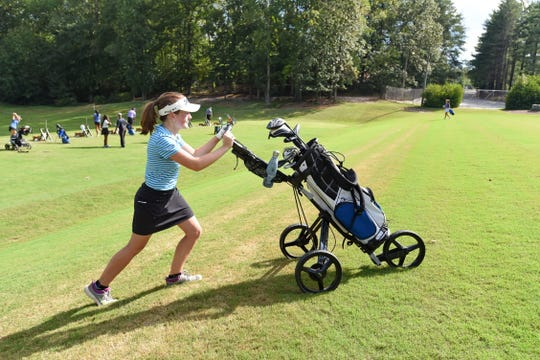 "It's been an uphill climb for St. Joseph's eighth-grader Marett Cole, but Shannon Cole said her daughter has found peace on the golf course: ""She could be out there all day."""