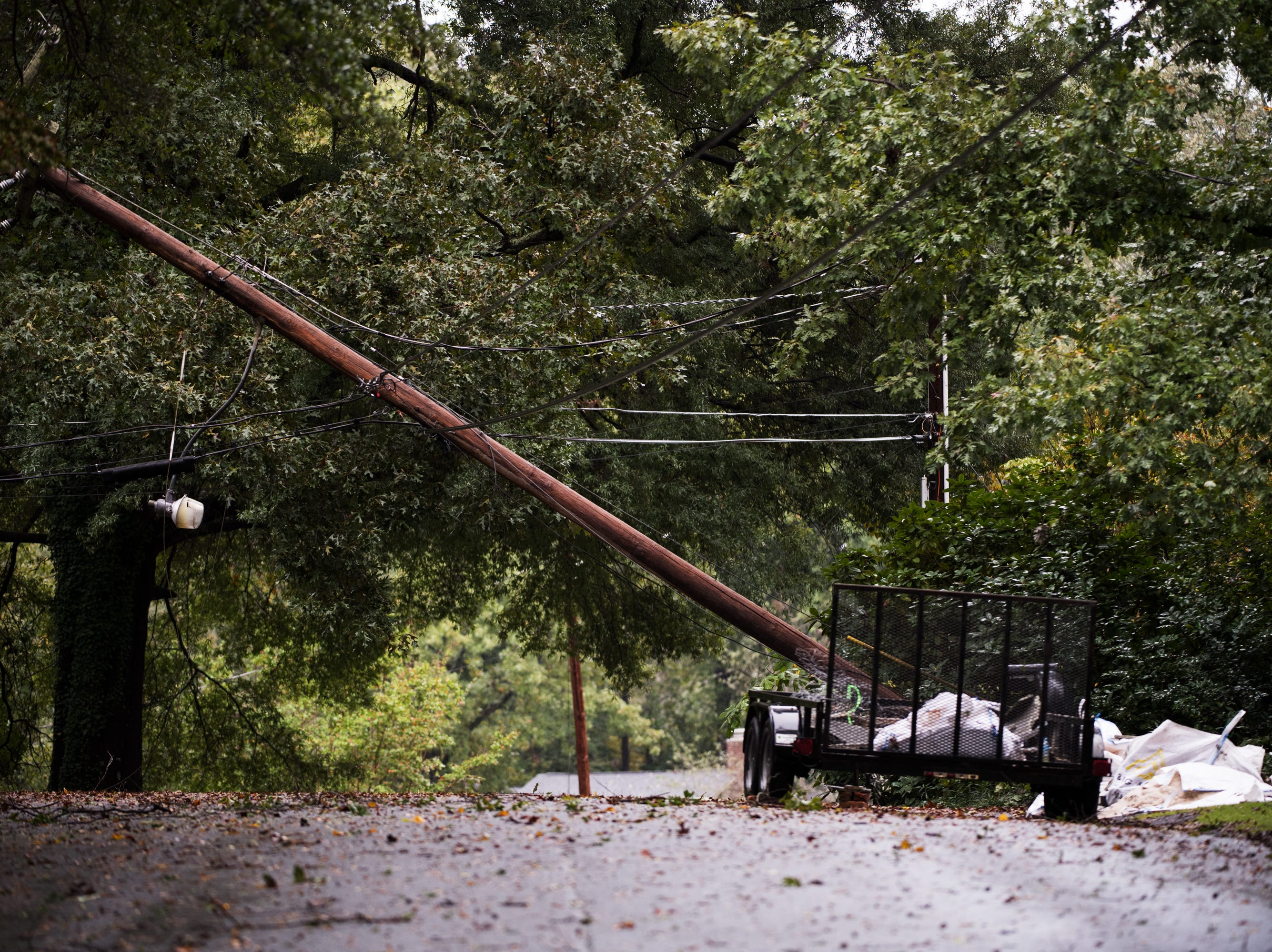 A down utility pole on Lotus Court near Chick Springs Road after Tropical Storm Michael hits the Greenville area on Thursday, Oct. 11, 2018.