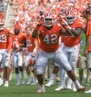 Clemson defensive lineman Christian Wilkins (42) celebrates the interception by teammate defensive back A.J. Terrell (8) against Syracuse during the fourth quarter in Memorial Stadium on Saturday, September 29, 2018.
