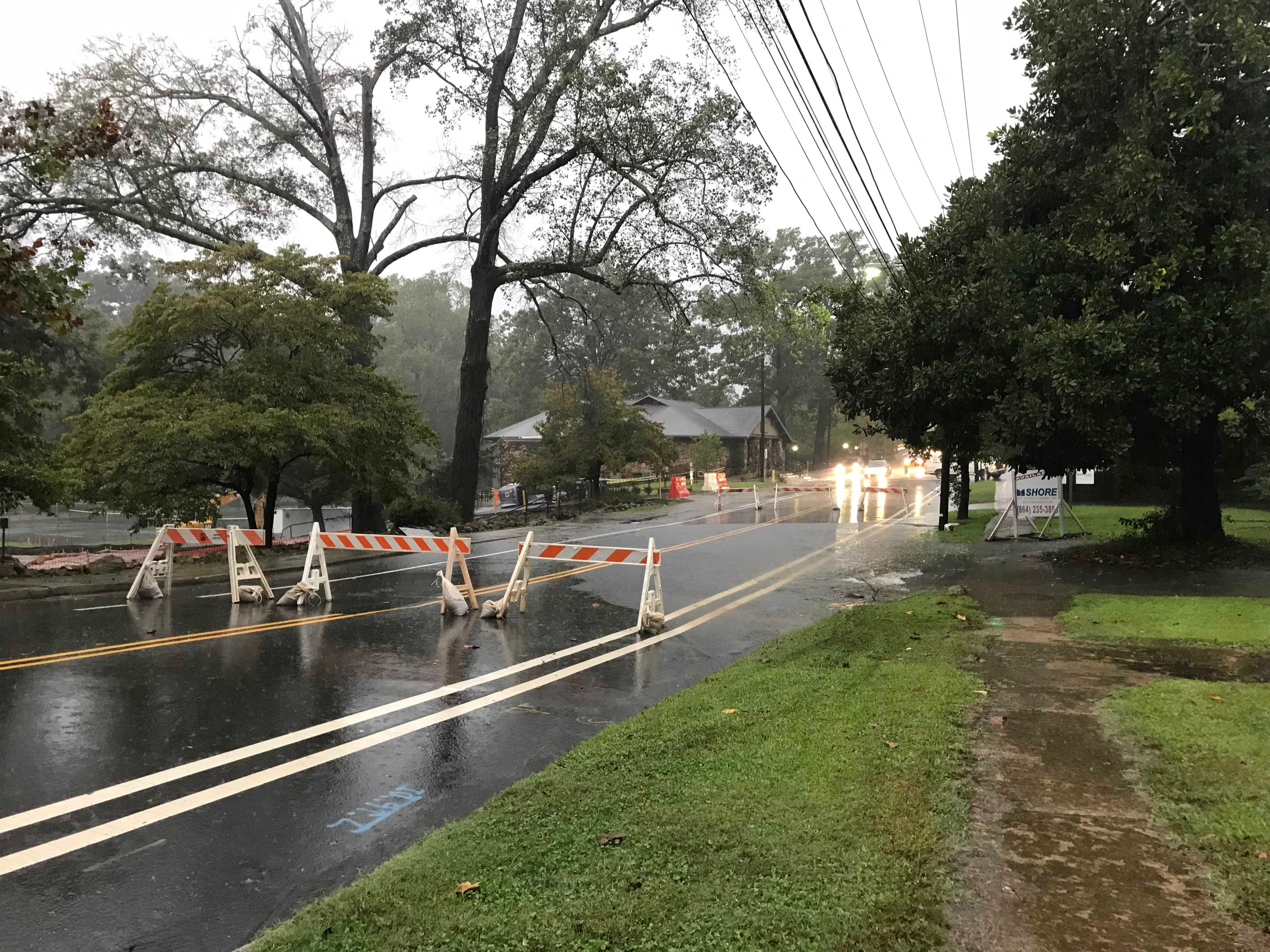East Park Avenue was shut down because of water logging near McPherson Park in Greenville on Thursday, Oct. 11, 2018, as heavy rain fell in the Upstate because of Tropical Storm Michael.