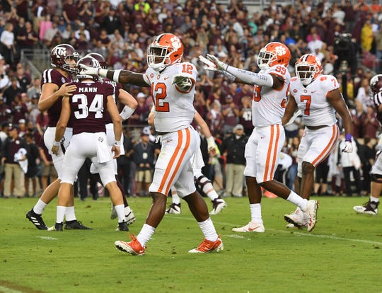 Clemson defensive back K'Von Wallace (12), defensive lineman Clelin Ferrell (99) and defensive lineman Austin Bryant (7) react after a missed field goal by Texas A&M kicker Braden Mann (34) during the 1st quarter at Texas A&M's Kyle Field in College Station, TX Saturday, September 8, 2018.