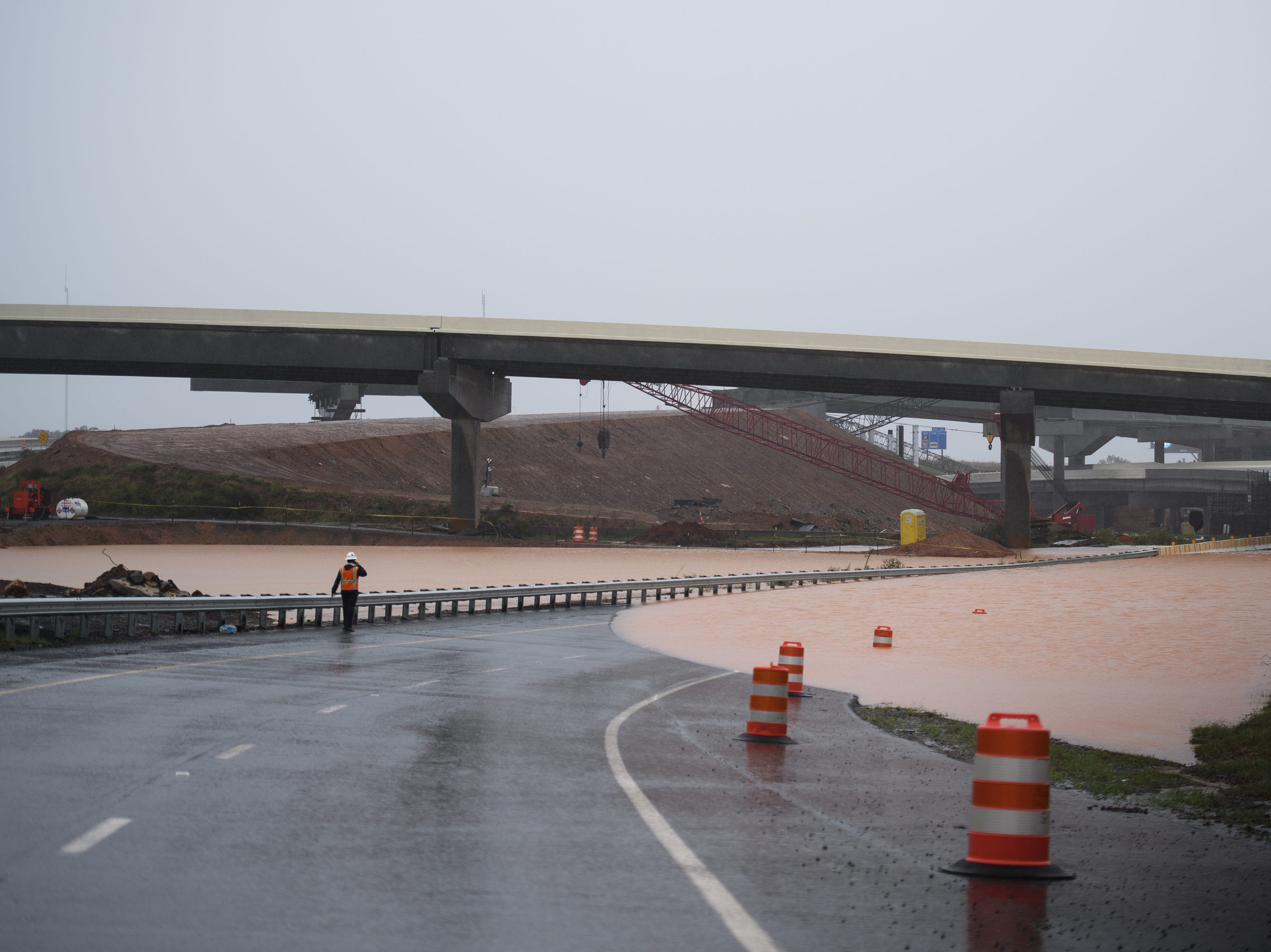 The Gateway Project at the intersection of Interstate 386 and 85 is flooded as Tropical Storm Michael hits the Greenville area on Thursday, Oct. 11, 2018.