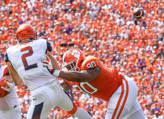 Clemson defensive lineman Dexter Lawrence (90) pressures Syracuse quarterback Eric Dungey(2) during the second quarter in Memorial Stadium on Saturday, September 29, 2018.