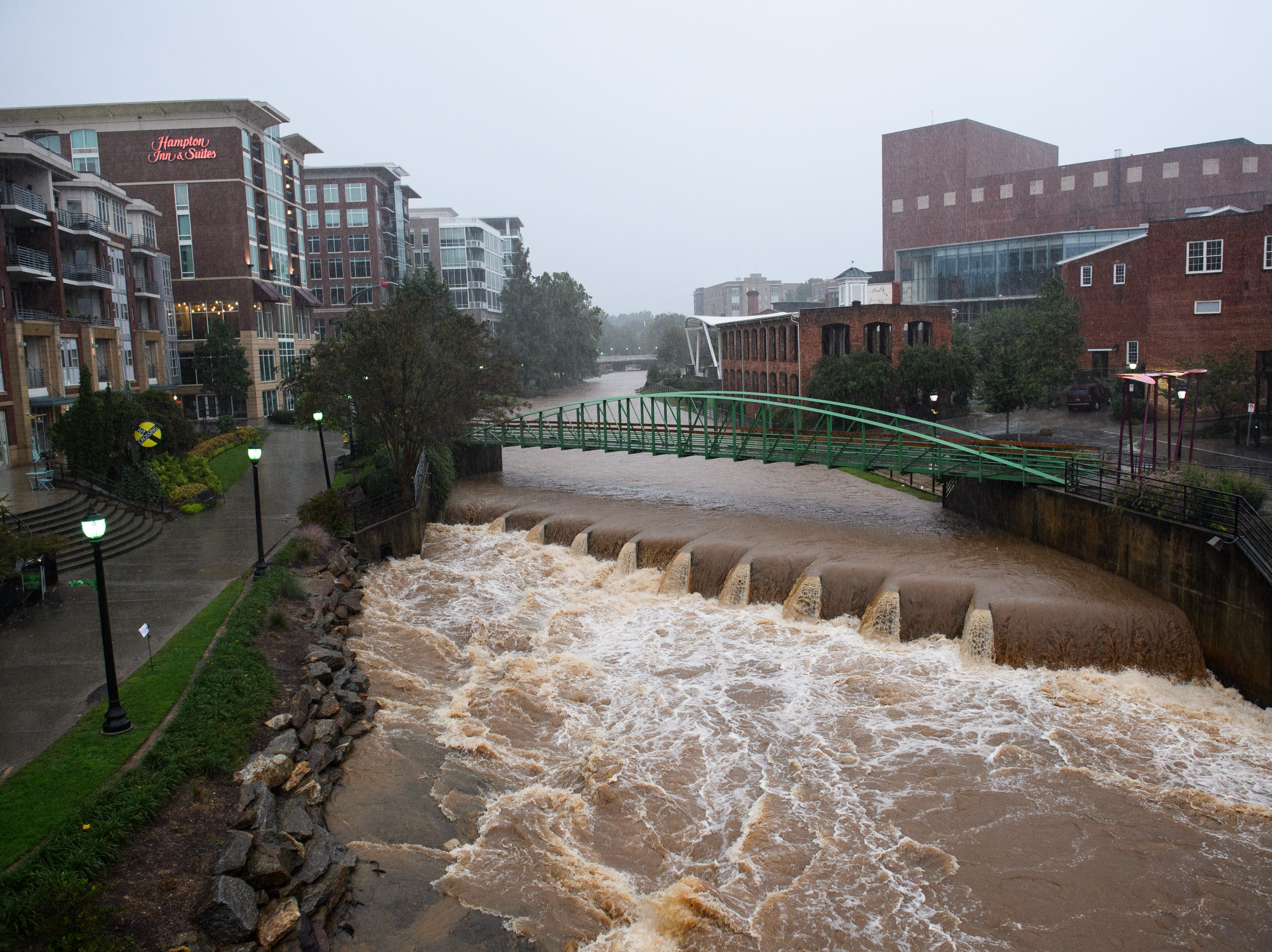 The Reedy River's water level rises as Tropical Storm Michael hits the Greenville area on Thursday, Oct. 11, 2018.