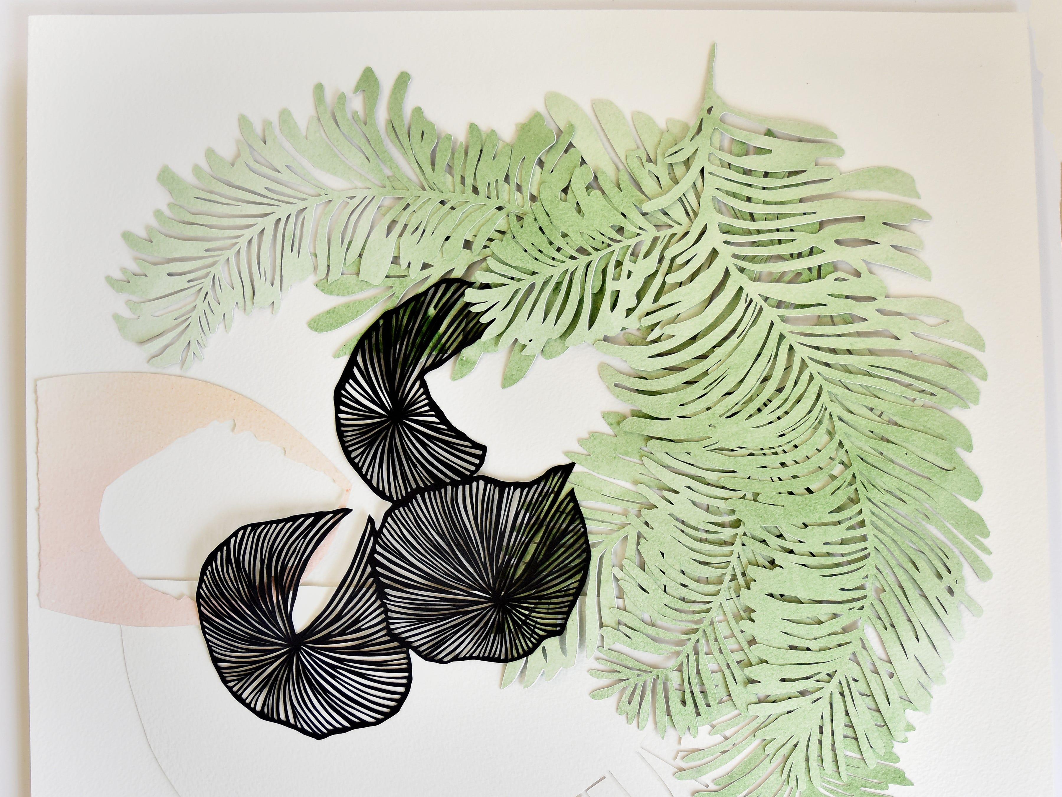 Cut paper art by Elizabeth speaker.