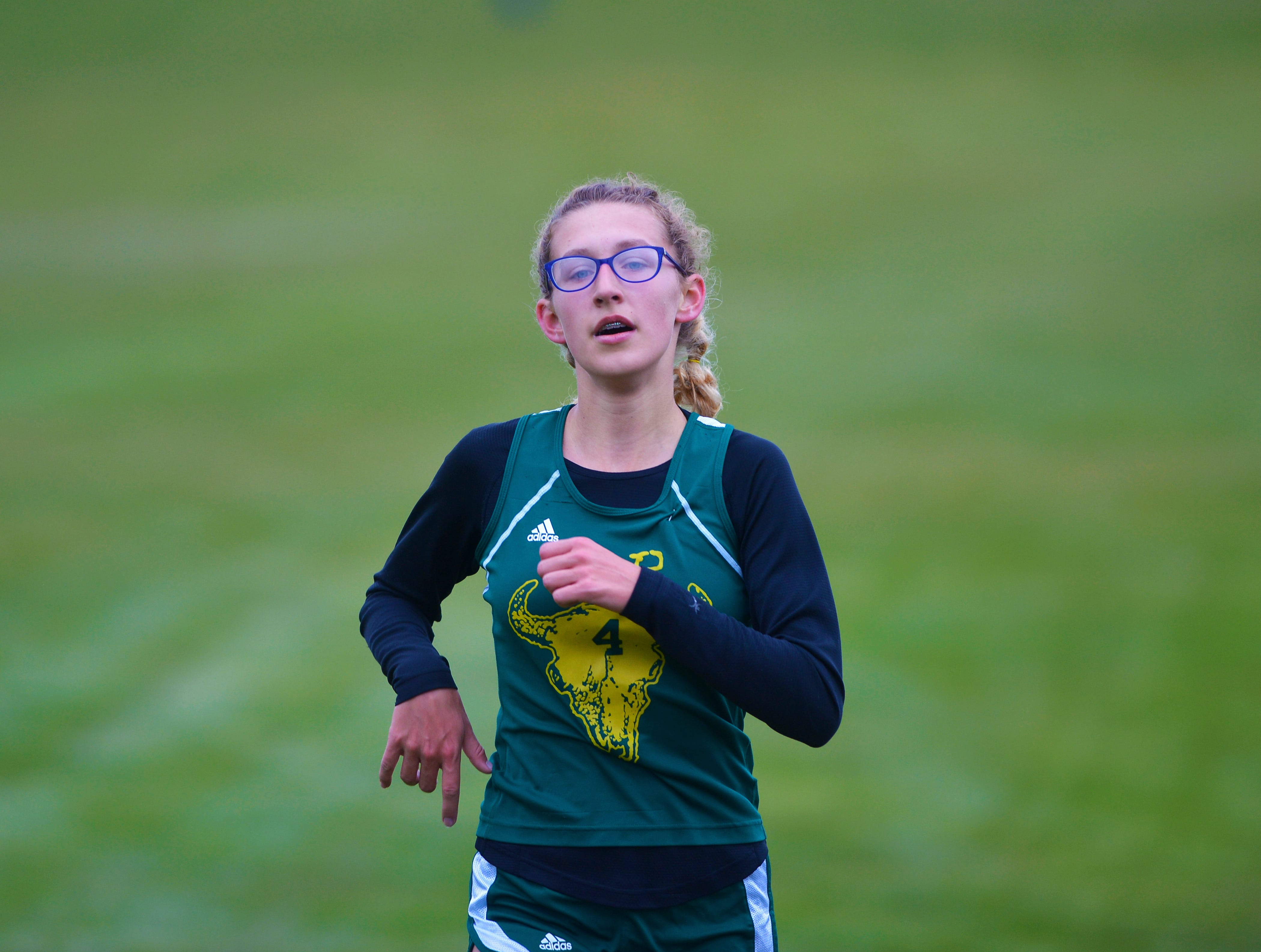 CMR's McKenzie Connell crosses the finish line in second during the crosstown cross country meet on Wednesday at Anaconda Hills Golf Course.