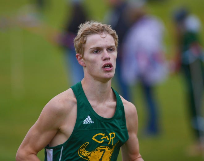 CMR's Gordon Gentry finishes first in the boys race during the crosstown cross country meet at Anaconda Hills Golf Course last October.