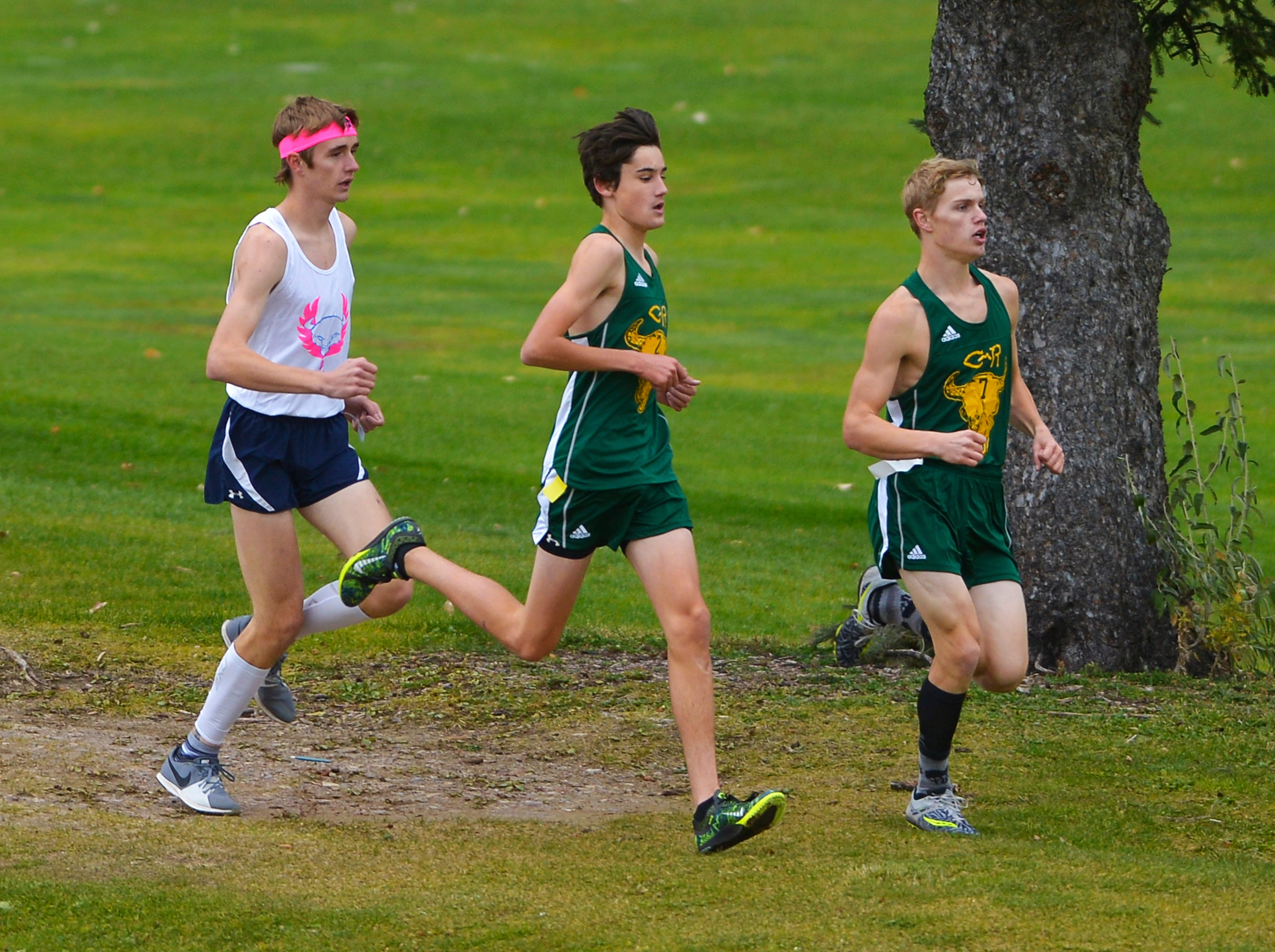 Great Falls High's Henry Kakalecik, left, hangs with CMR's Connor O'Hara, center, and Gordon Gentry during the crosstown cross country meet on Wednesday at Anaconda Hills Golf Course.