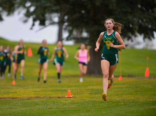 CMR's MacKenzie Dean leads the field from wire to wire, winning the girls race at the crosstown cross country meet last October at Anaconda Hills Golf Course.