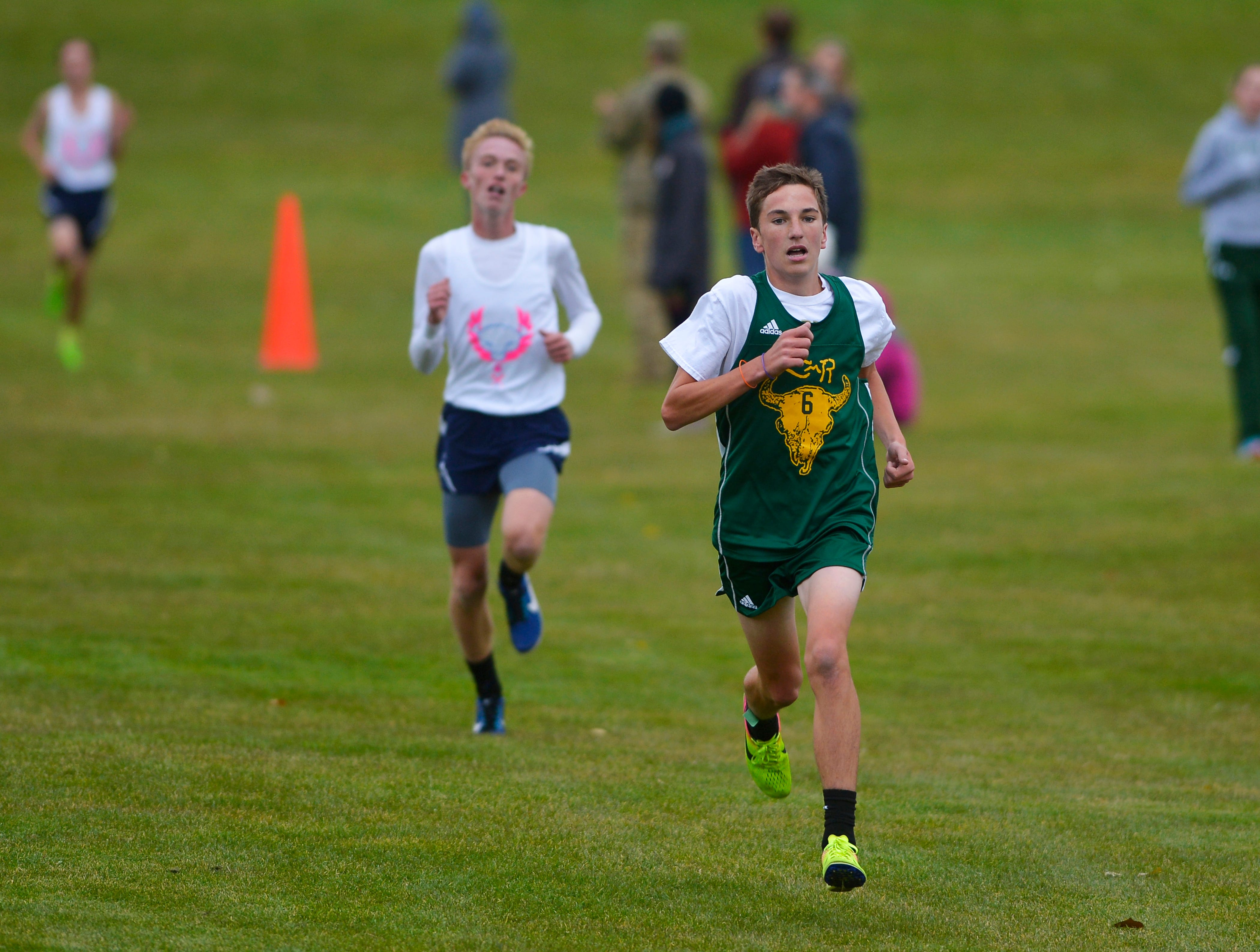 CMR's Brycen Gardner sprints to the finish during the crosstown cross country meet on Wednesday at Anaconda Hills Golf Course.