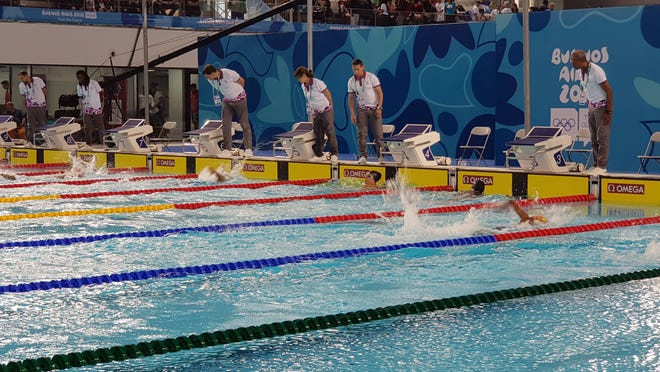 Margie Winter, swimmer from Federated States of Micronesia, looks up at her time after taking first place in her heat. Swimmers from Palau and Marshall Islands also competed in women's 50m freestyle at the Buenos Aires Youth Olympic Games on Oct. 11, 2018.