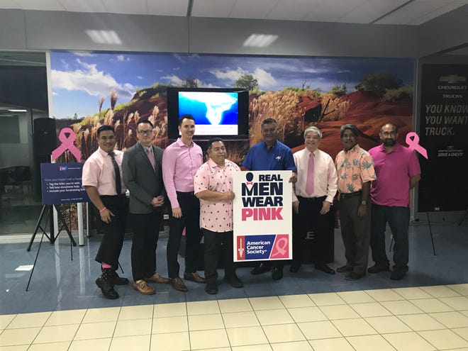Real Men Wear Pink candidates, from left, Glen Noket, Felix Cabrera, Jon Nathan Denight, Joseph San Agustin, Thomas Garcia, Joel Rubio, Francis Santos and Steven Pangelinan are wearing pink throughout the month as they compete to raise money in the fight against breast cancer. The American Cancer Society's reveal event was held Wednesday night at the Atkins Kroll Chevrolet showroom.