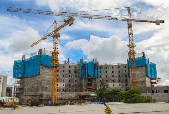 Contractors continue work on the new Tsubaki Tower in Tumon on Thursday, Oct. 11, 2018. The luxury 26-story, 340 guest room hotel was originally planned to be completed this month but due to unforeseen construction delays,is now rescheduled to open in2019, according to Milton Morinaga, PHR Ken Micronesia managing director.
