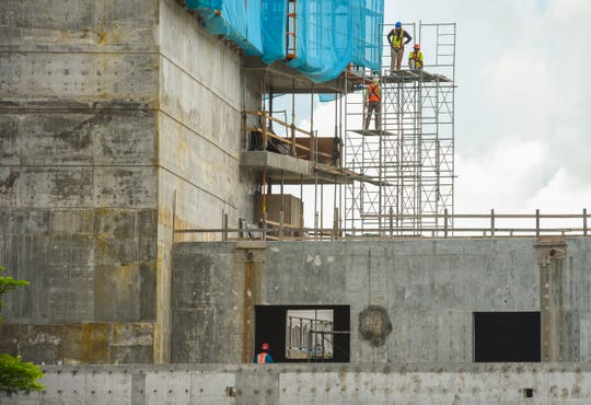 Contractors continue work on the new Tsubaki Tower in Tumon on Thursday, Oct. 11, 2018. The luxury 26-story, 340 guest room hotel was originally planned to be completed this month but due to unforeseen construction delays, is now rescheduled to open in 2019, according to Milton Morinaga, PHR Ken Micronesia managing director.