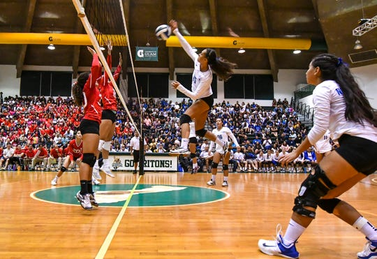 In this file photo from October 2018, the Notre Dame Royals, in white, face off against the St. John's Knights in the High School Girls Volleyball Championship game held Oct. 11, 2018 at the University of Guam Calvo Field House. While the Knights are looking for a third straight preseason tournament crown, the two-time defending champion Royals look to win a third-straight IIAAG title.