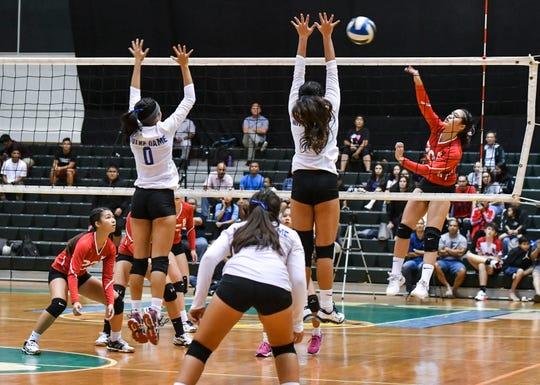 The Notre Dame Royals went face-to-face at the net with the St. John's Knights during the championship matchup of the Independent Interscholastic Athletic Association of Guam High School Girls Volleyball league action at the University of Guam Calvo Field House on Thursday, Oct. 11, 2018. The Royals managed to win three games straight, 25-19, 25-22 and 25-21, to capture the championship title.
