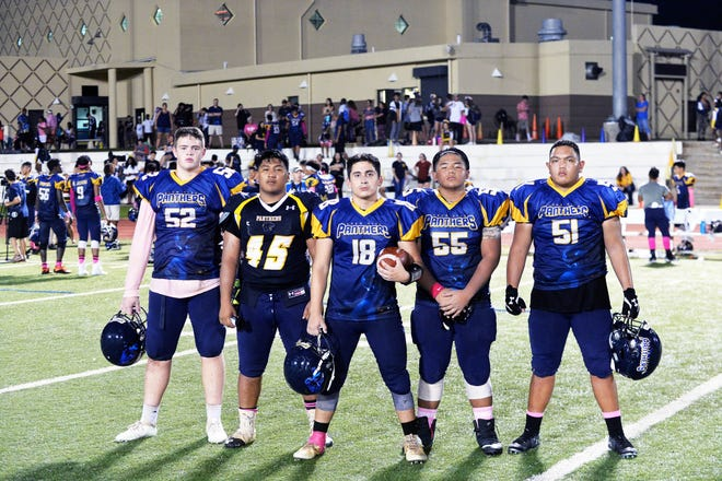 The Guam High Panthers offensive line made sure its bullets had the room and time to score. They are from left, Maxwell Lindfors, Curtis Bukikosa, Drew Mestas, Matua Whalen and Ashton Gamboa.