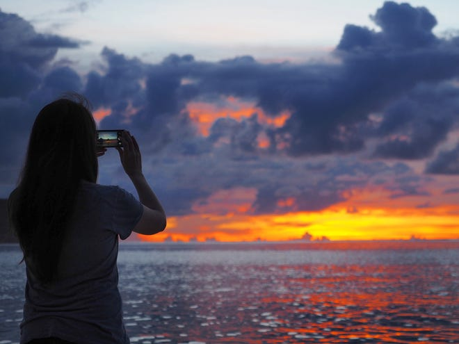 Photo of the Week winner Kazuki Hasegawa captured this sunset, as his wife does on her phone, in Tumon on Aug. 12, 2018.