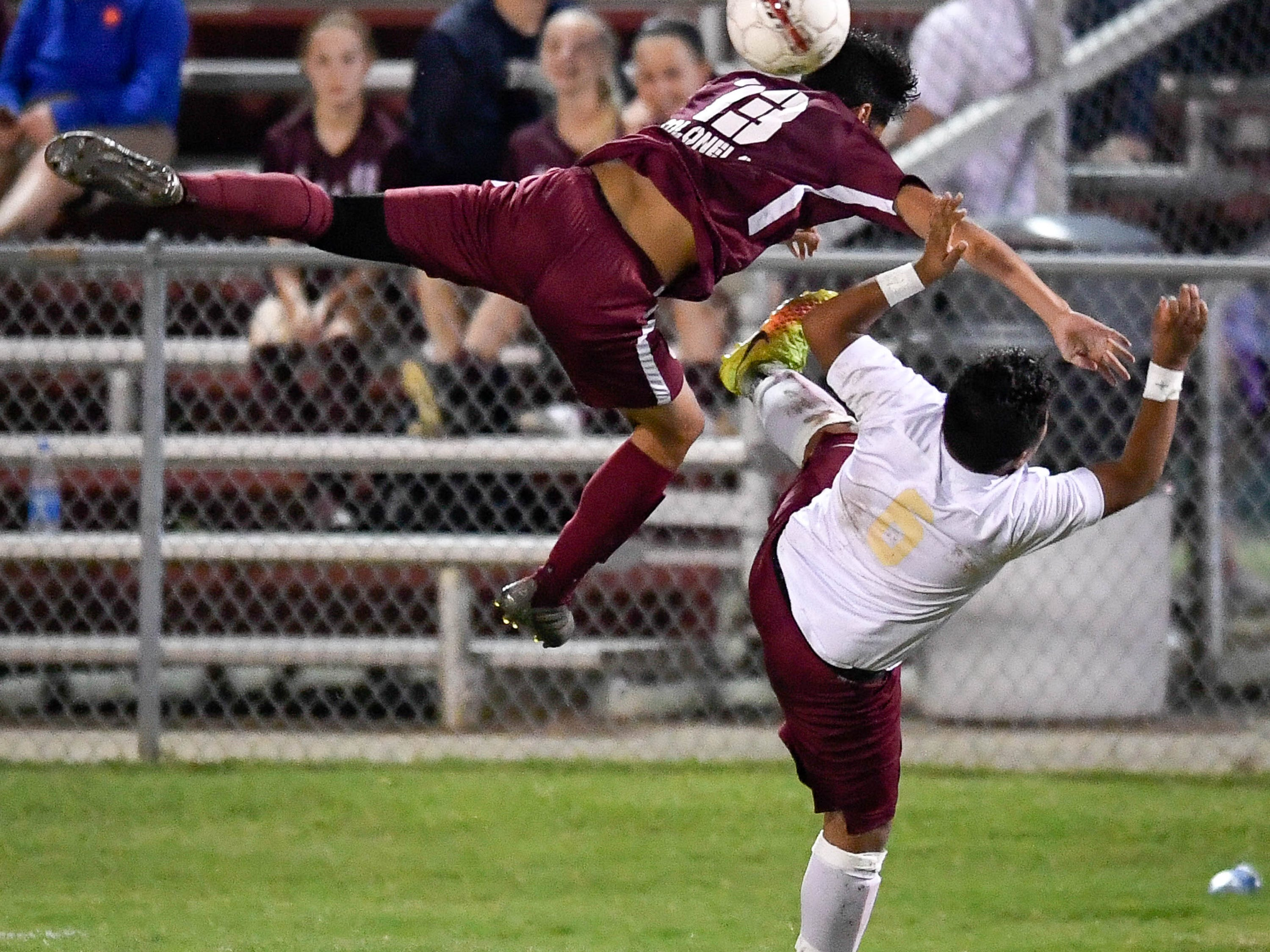 Henderson County's Ed Zeron (13) and Webster's Jorge Martinez (6) try to head the ball as the Henderson County Colonels play the Webster County Trojans in the Sixth District Soccer Tournament at Colonel Field Wednesday, October 10, 2018.