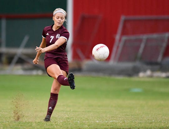 Henderson's Carlee Crafton (7) kicks the ball down field as the Henderson County Lady Colonels play the Webster County Lady Trojans in the Sixth District Soccer Tournament at Colonel Field Wednesdayt, October 10, 2018.
