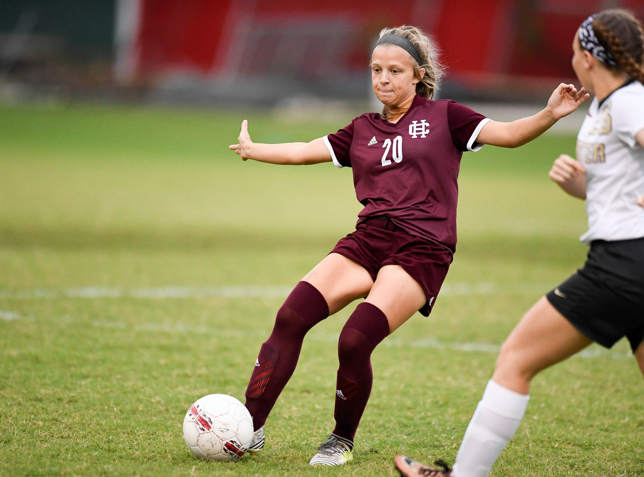 Henderson's Morgan Greene (20) passes the ball as the Henderson County Lady Colonels play the Webster County Lady Trojans in the Sixth District Soccer Tournament at Colonel Field Wednesdayt, October 10, 2018.