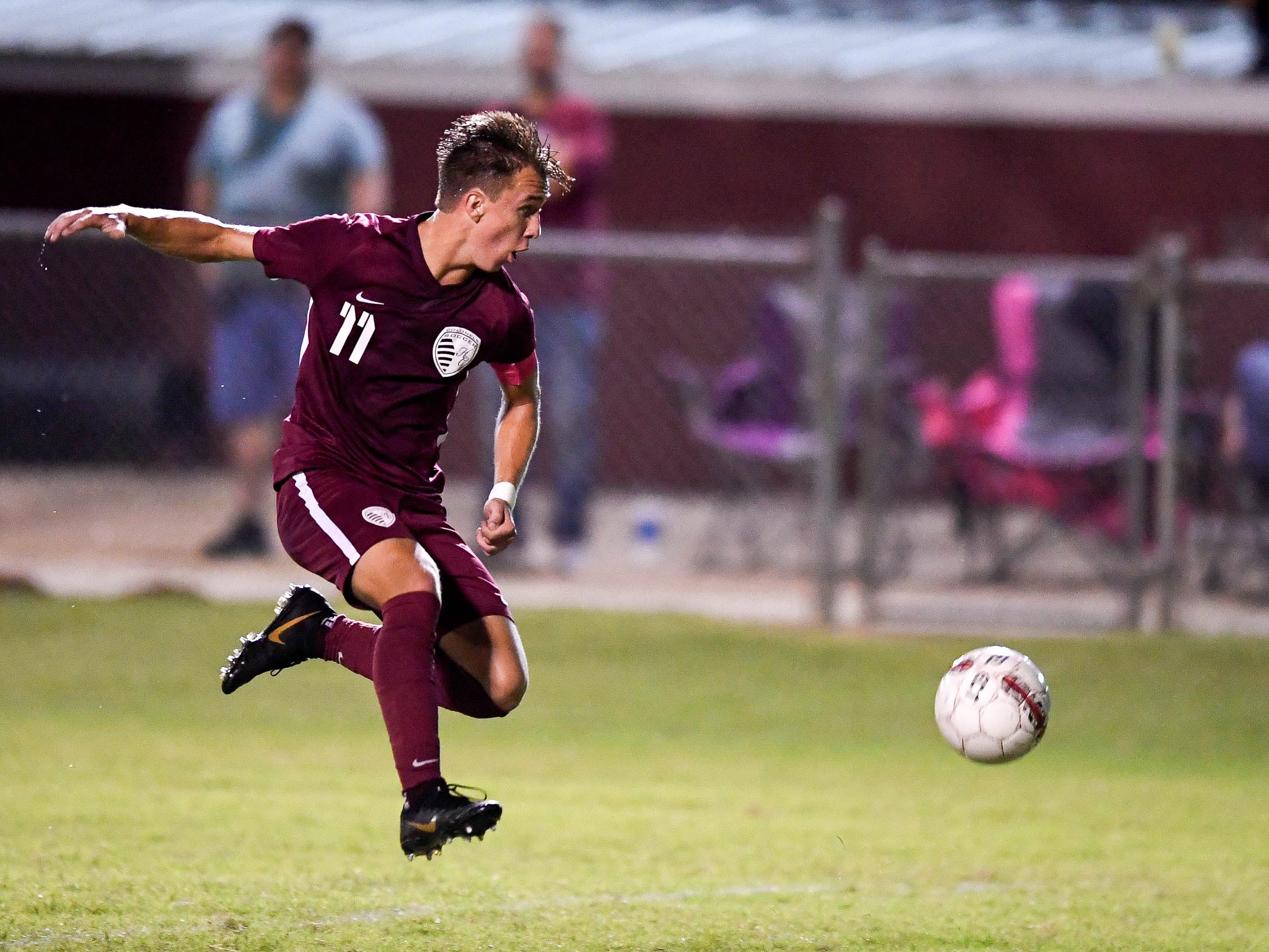 Henderson County's Max Wawrin (11) pushes the ball up field as the Henderson County Colonels play the Webster County Trojans in the Sixth District Soccer Tournament at Colonel Field Wednesday, October 10, 2018.
